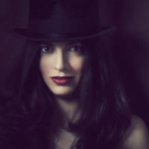 Fine art portrait of woman with hat